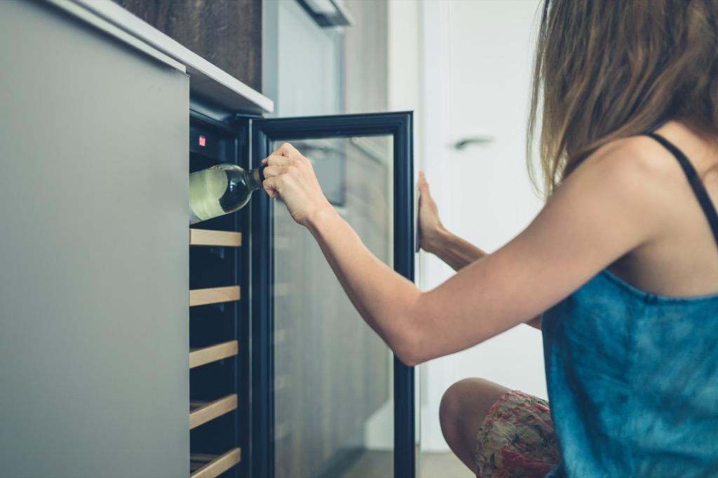 woman reaching into wine fridge, home upgrades