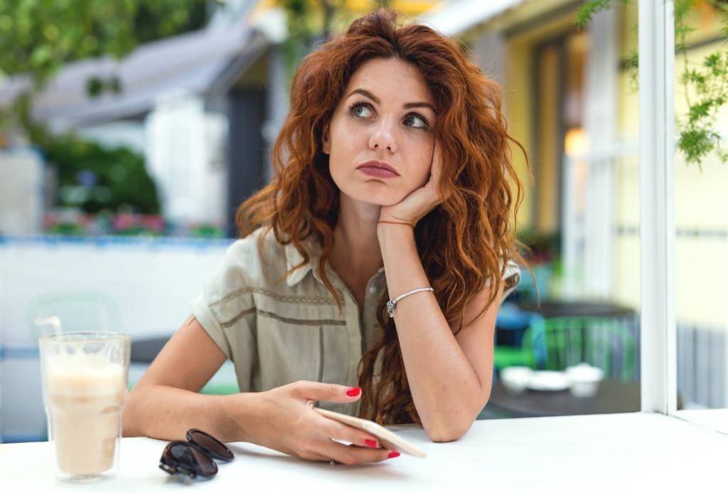 woman annoyed at restaurant