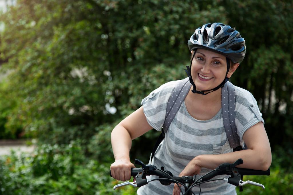 older woman biking, bicycling, exercising