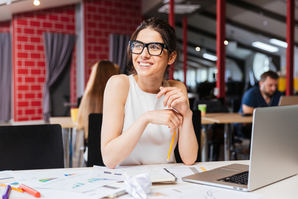 Woman Smiling at Work New Year's Resolutions