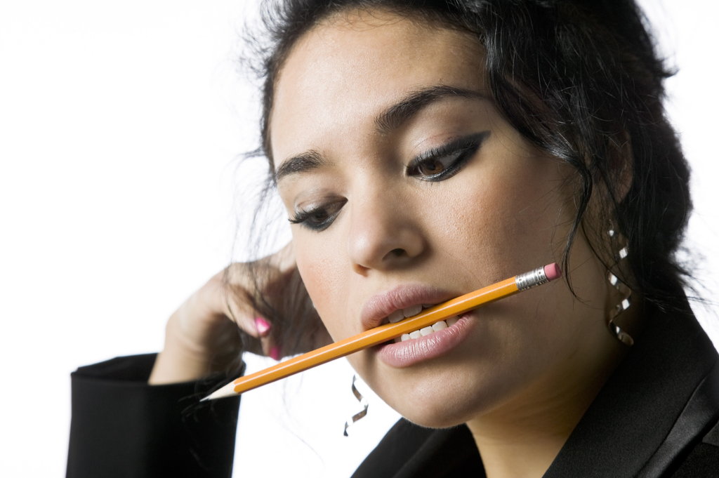 Woman with Pencil in Mouth Things That Would Horrify Your Dentist