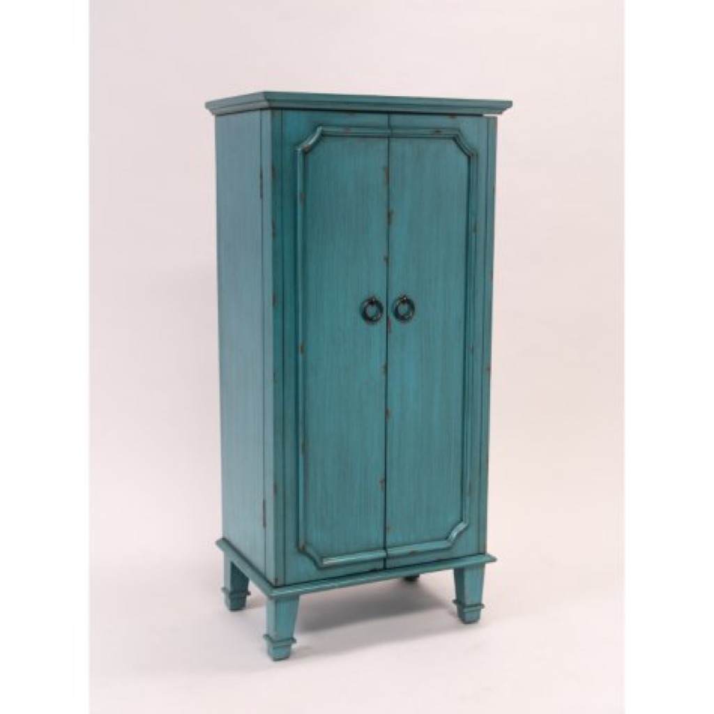 A turquoise armoire with jewelry holder