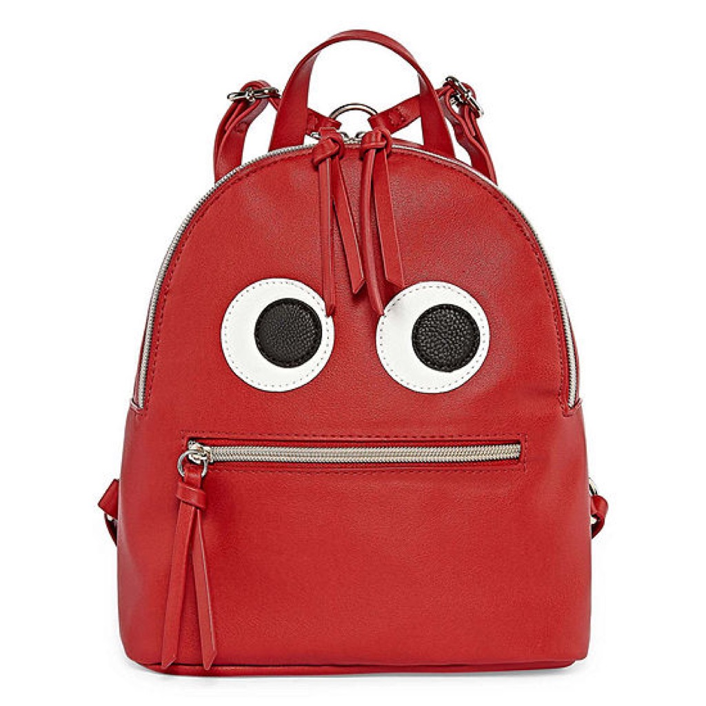A red backpack with eyes