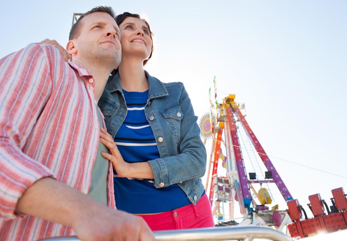 Amusement park older couple