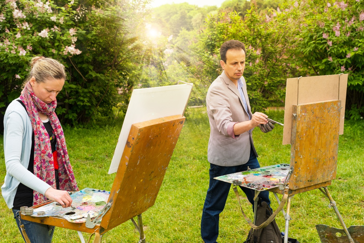 Couple doing art outdoors