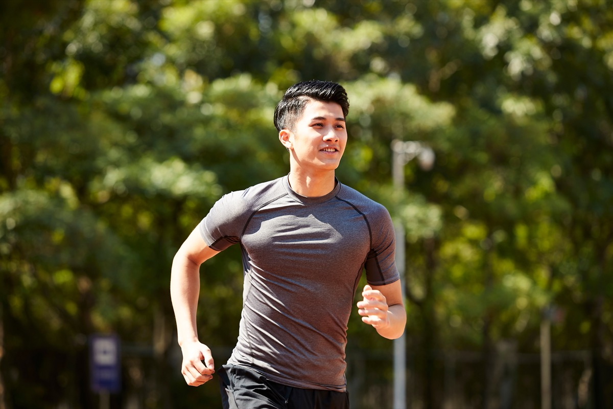Asian man going for a run outside