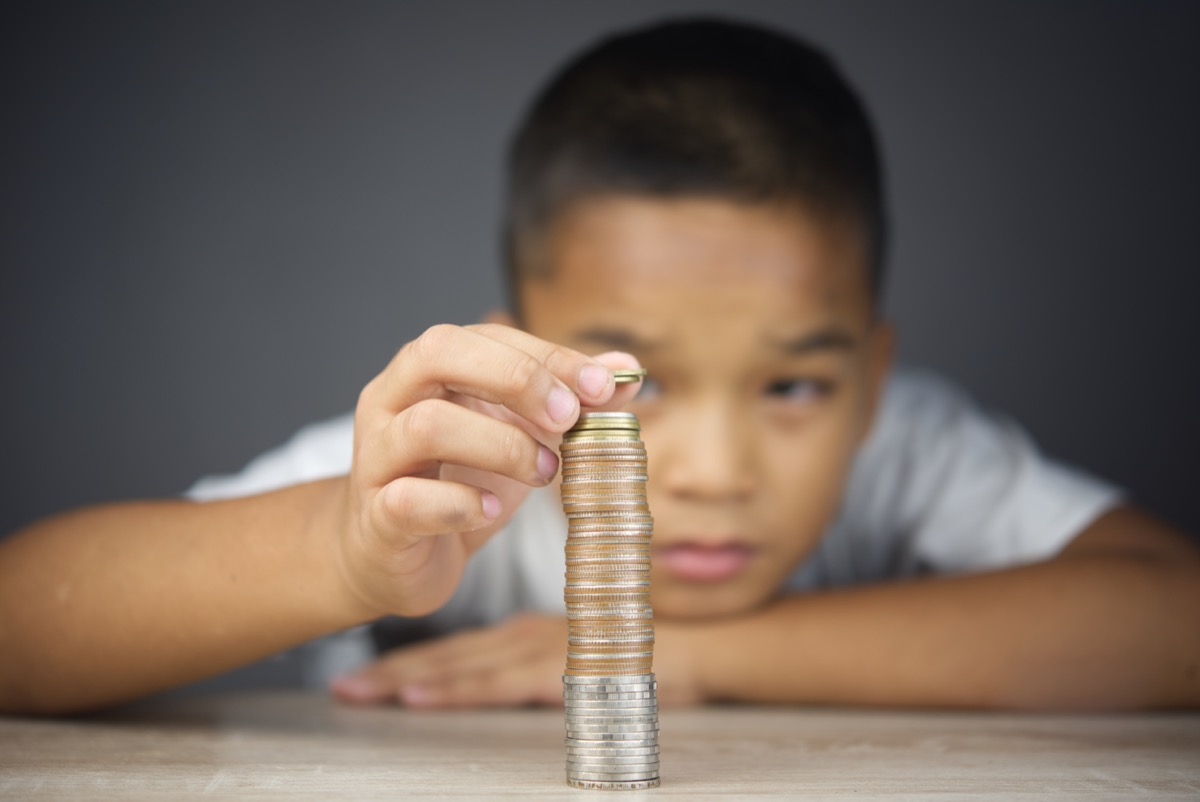 Young boy counting change coins