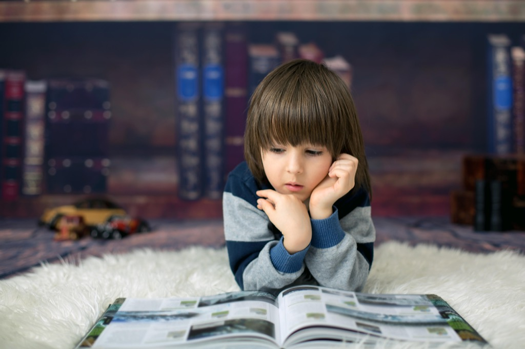 cute kid in home library
