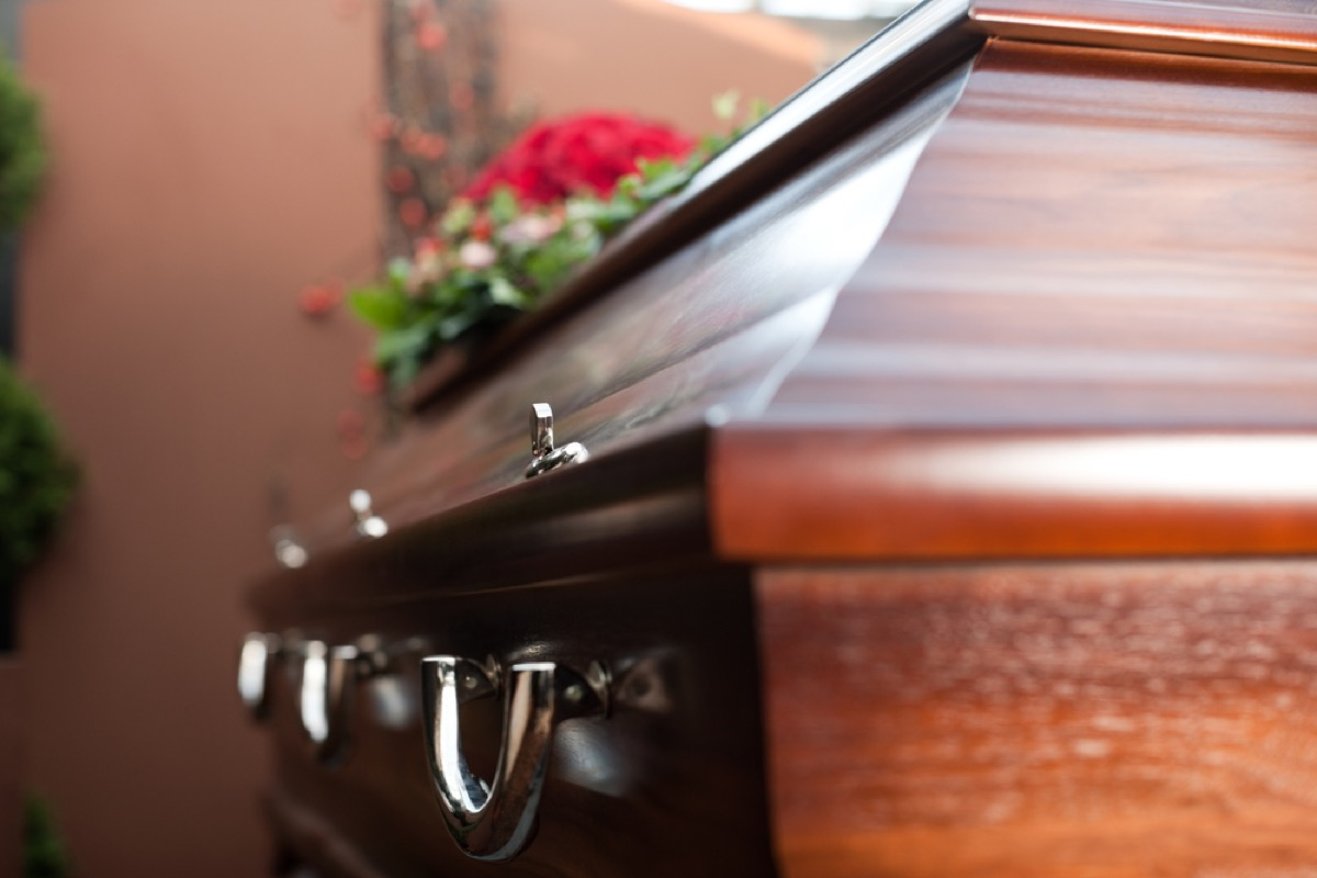 closeup of casket with flowers