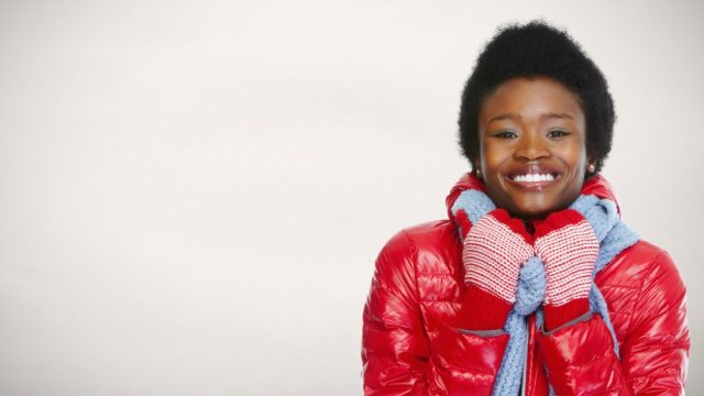 black woman in puffy coat smiling