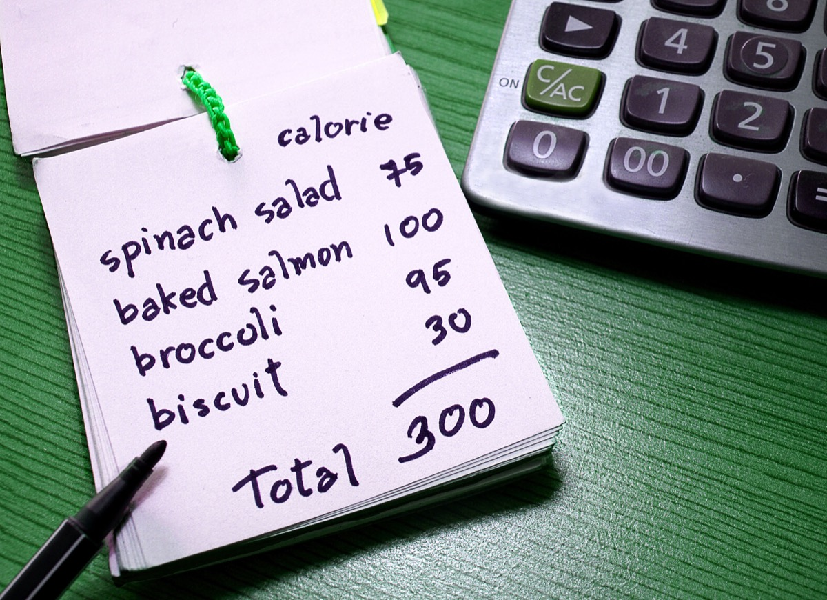Person counting calories for weight loss