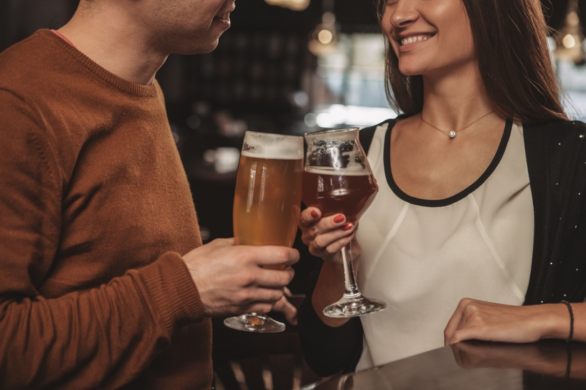 a couple drinking beers at a craft brewery, date night ideas