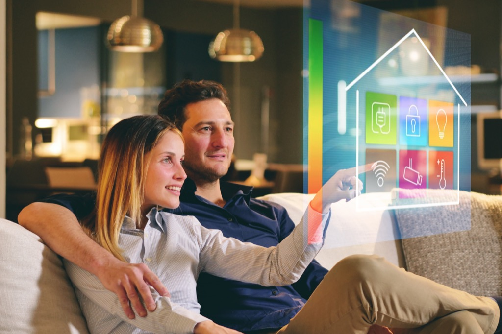 couple sitting on a sofa in a smart home