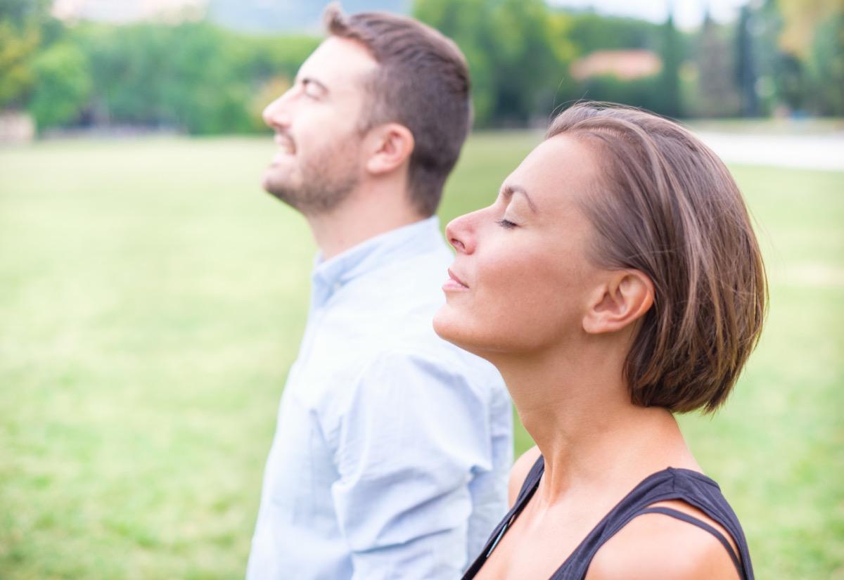 Meditating Adults Taking Deep Breaths {Breathing Problems}