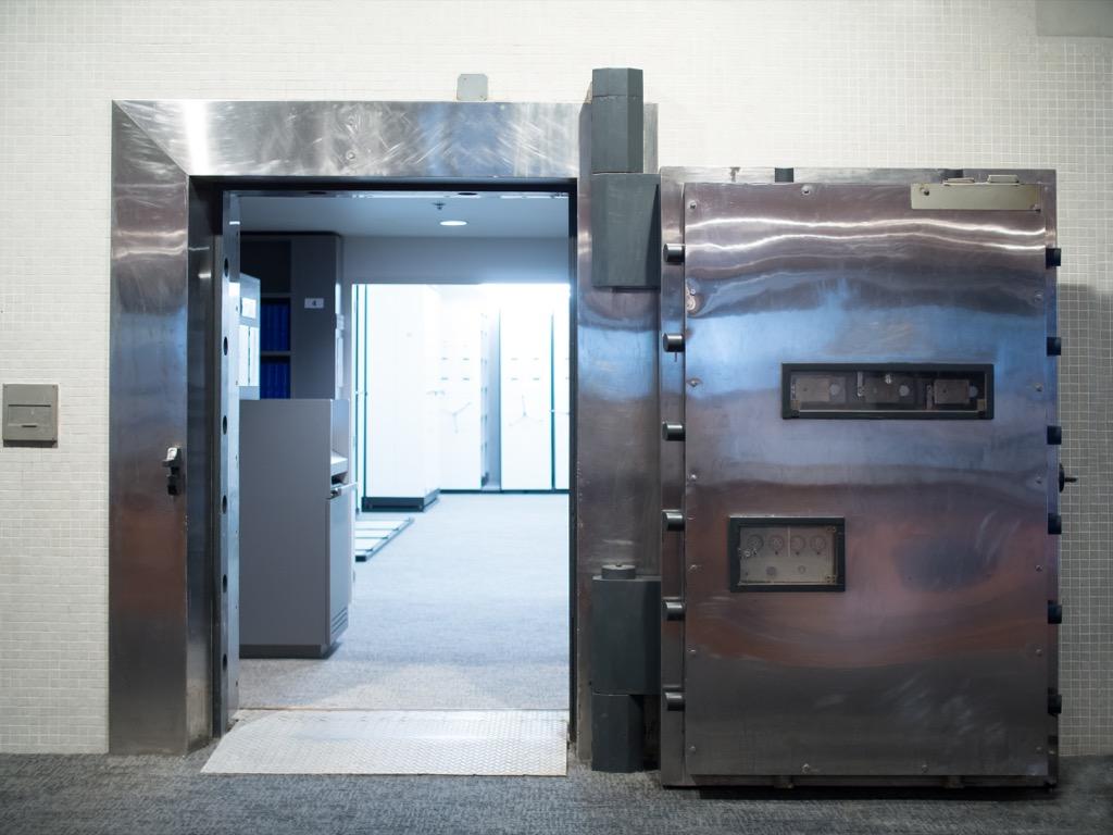 an open steel door looking into a disaster room