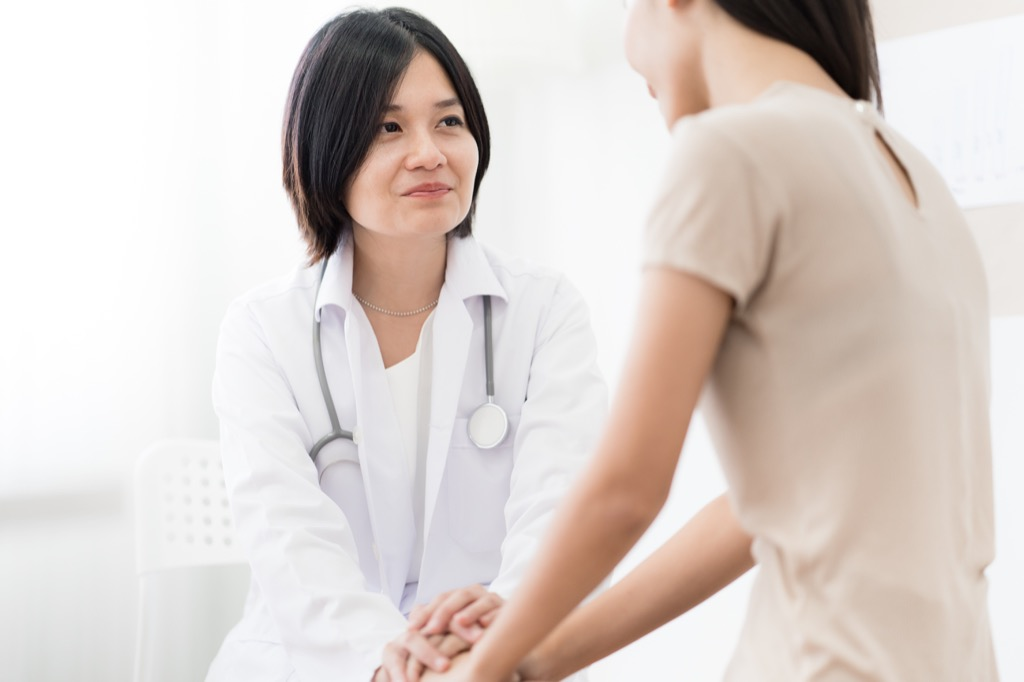 woman at the doctor ways we're unhealthy