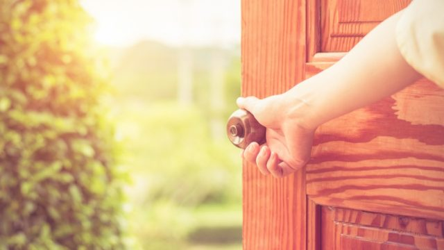 doorknob woman opening door, things you should clean every day