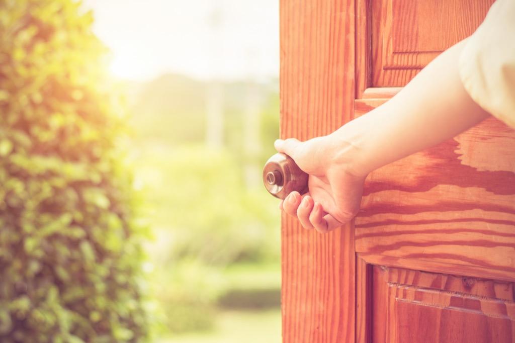 doorknob woman opening door home problems