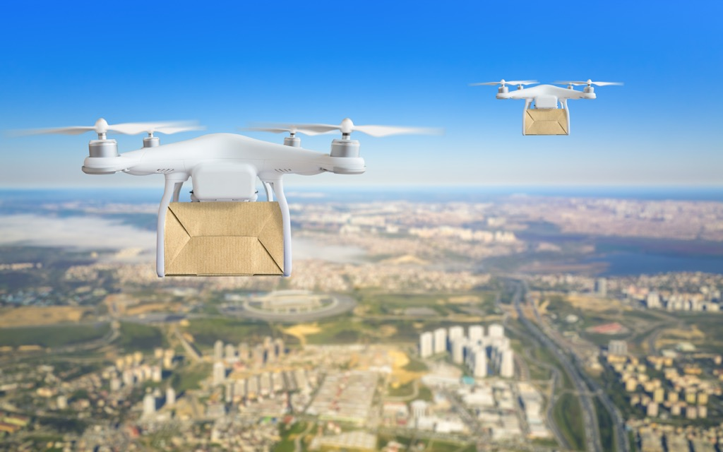drones delivering packages in the sky above an urban landscape