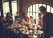 family at thanksgiving dinner - holiday stress