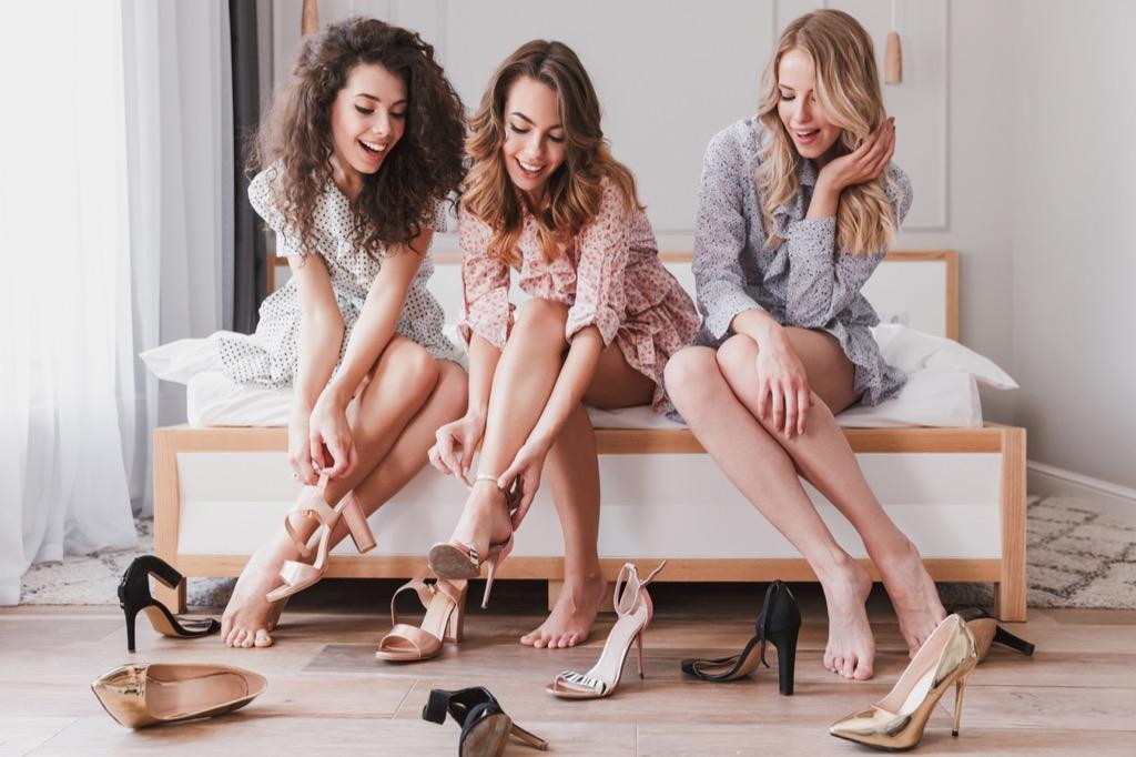 women putting on heels in a bedroom