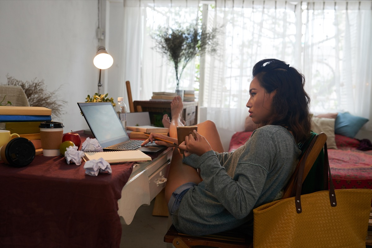 Girl studying in dorm room