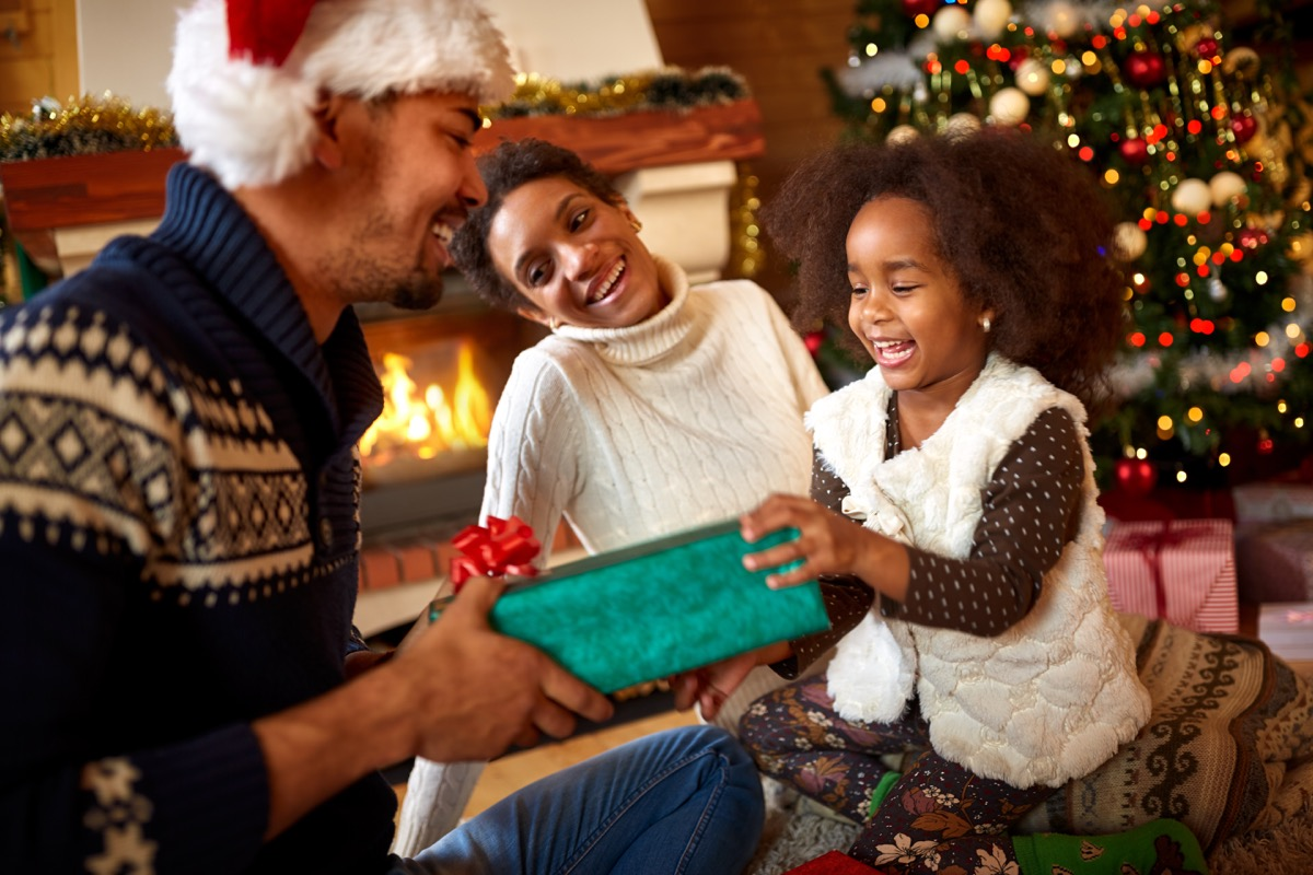 Happy Family Opening Presents Dealing with Holiday Stress