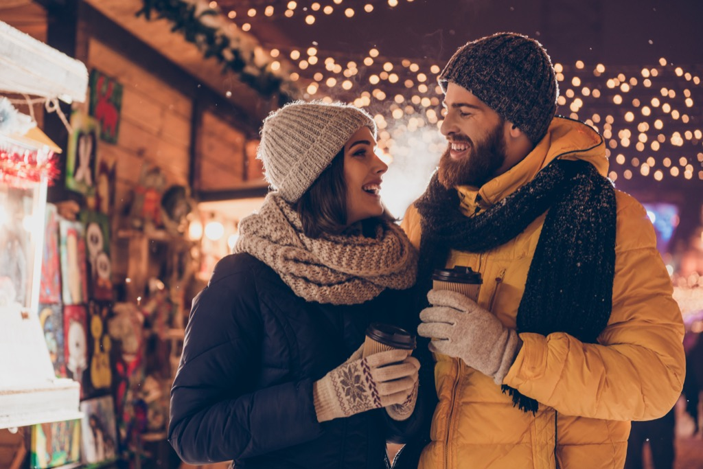 couple looking at christmas lights, date night ideas