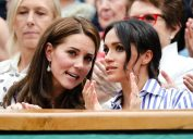 London, UK, 14th July 2018: Catherine Kate Duchess of Cambridge and Meghan, Duchess of Sussex, visiting the men's semifinal at day 12 at the Wimbledon Tennis Championships 2018 at the All England Lawn Tennis and Croquet Club in London.