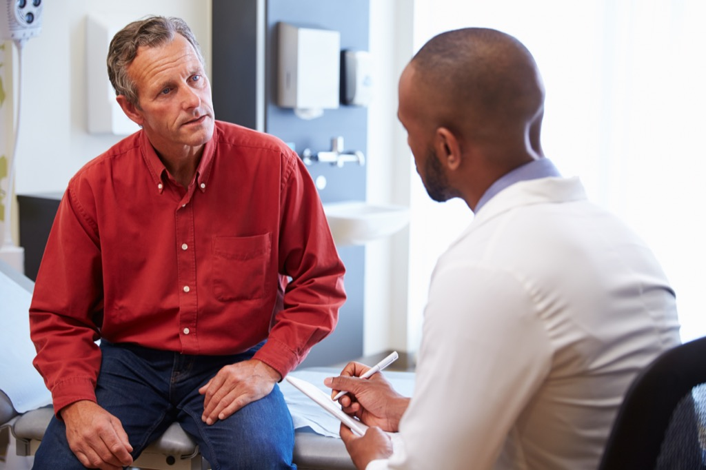 man getting bad news at a doctor checkup, heart risk factors