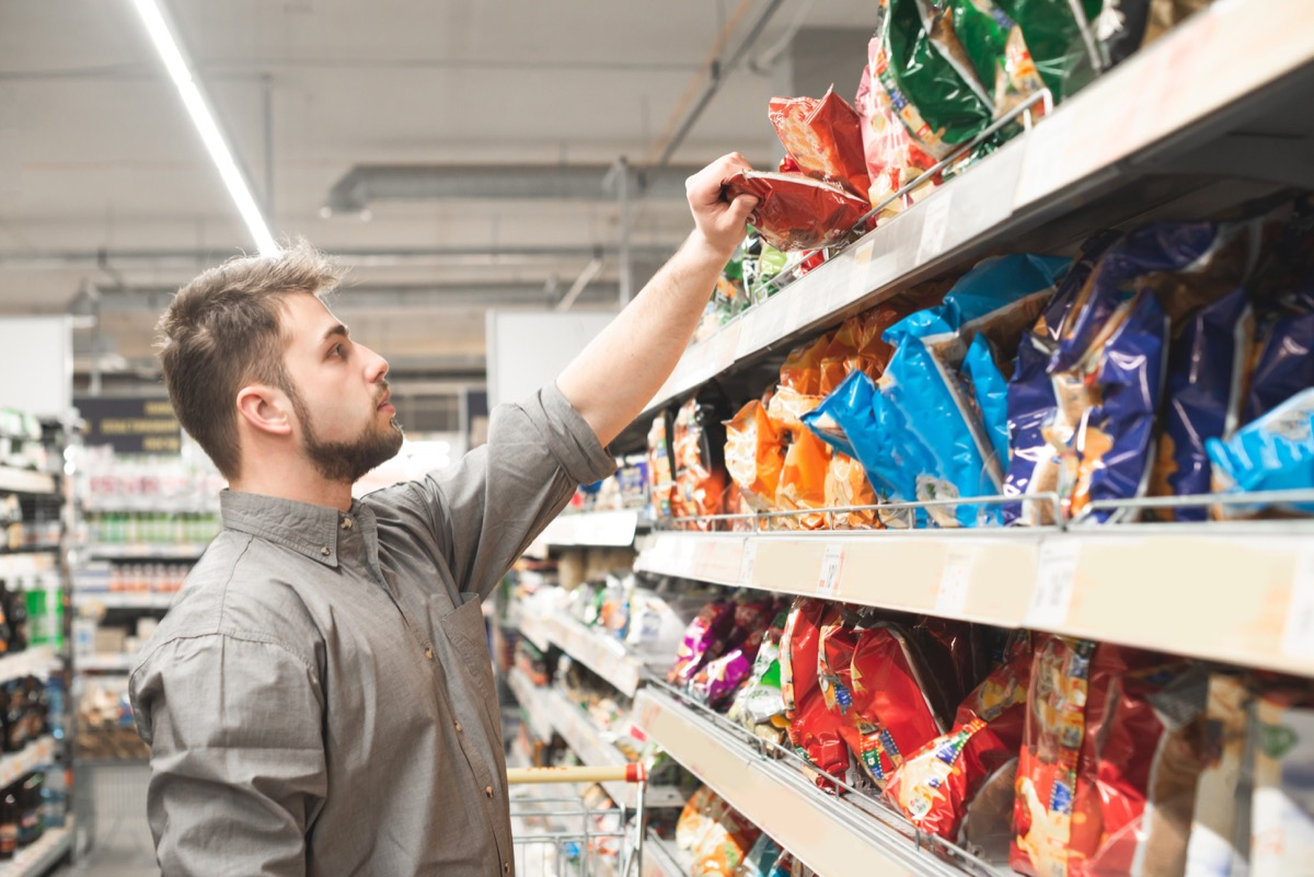 Man buying chips at the grocery store