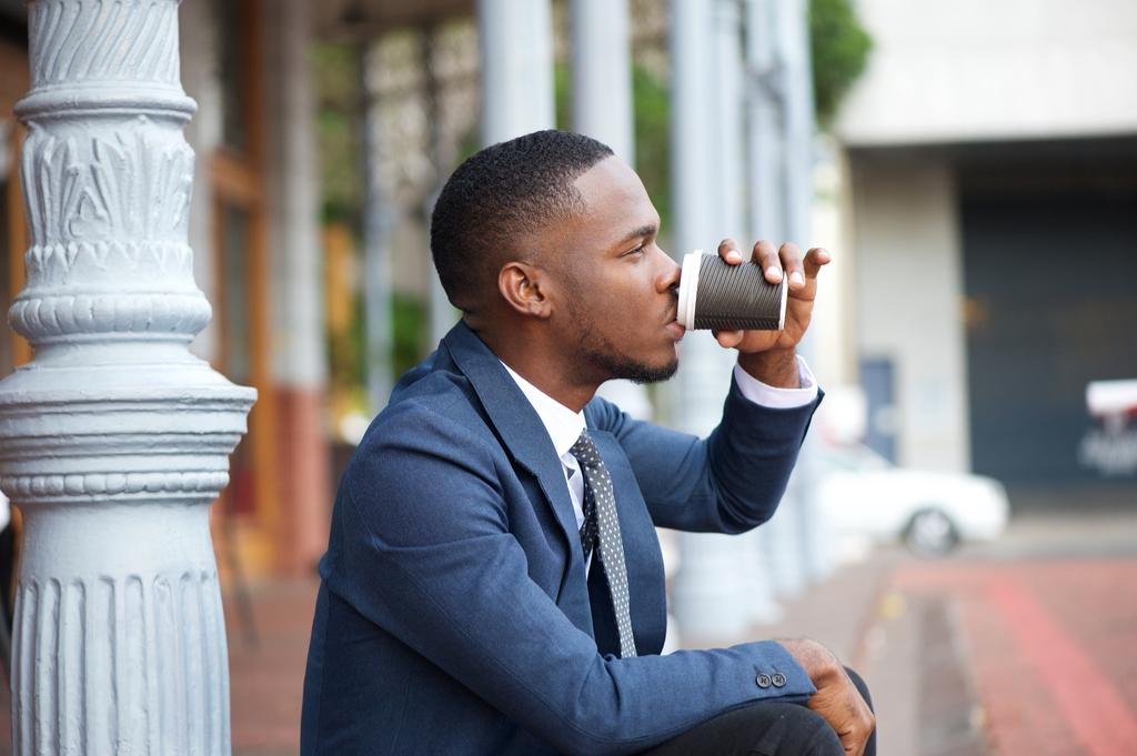 man drinking espresso outside ways we're unhealthy