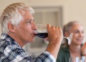 Mature man drinking a glass of red wine