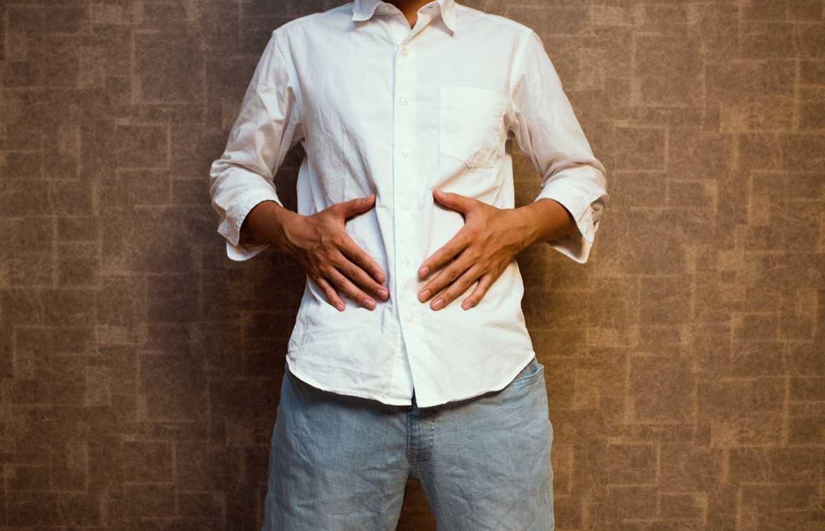 Man holding his stomach with hunger pangs