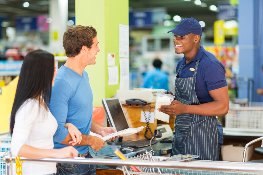 Man Ringing Out Customer Worst Things to Say to a Cashier
