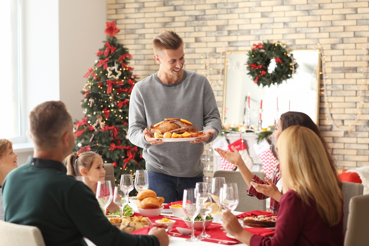 Man Serving Turkey Dealing with Holiday Stress
