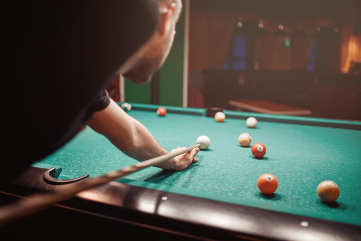 Man shooting pool billiard