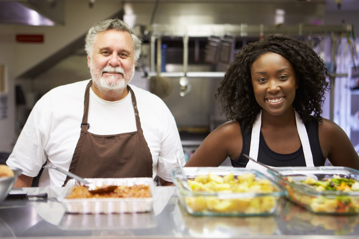Man and Woman Volunteering at a Soup Kitchen How to Make Friends as an Adult