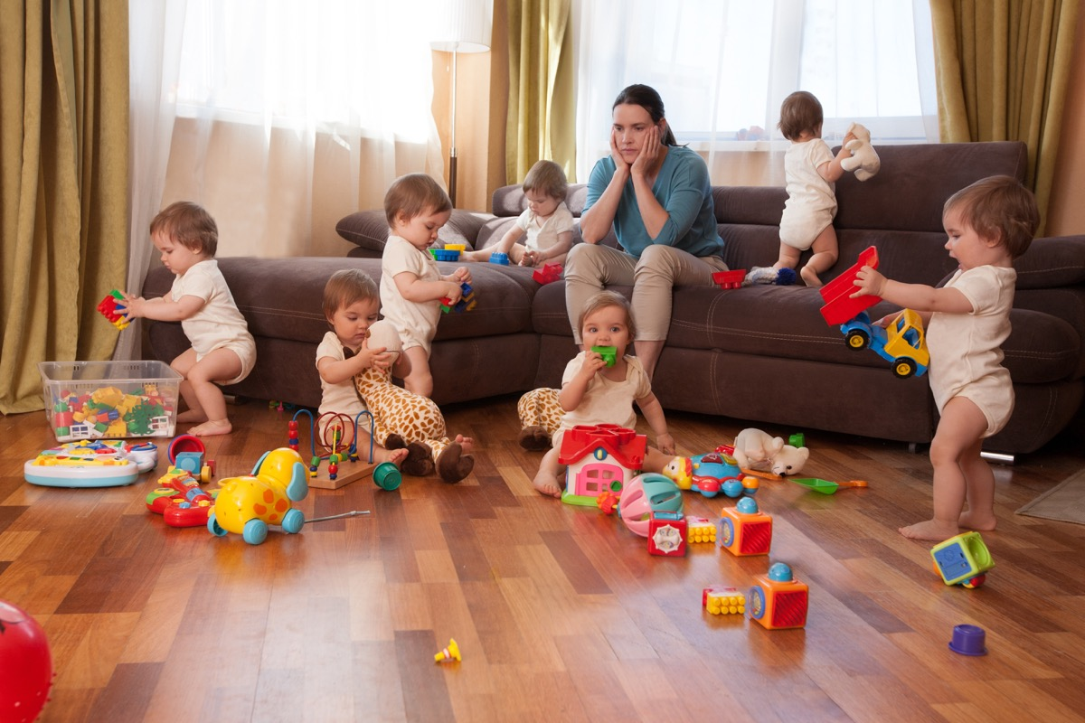 Mim sitting on couch overwhelmed by a lot of kids