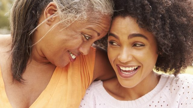 mother smiling with her adult daughter