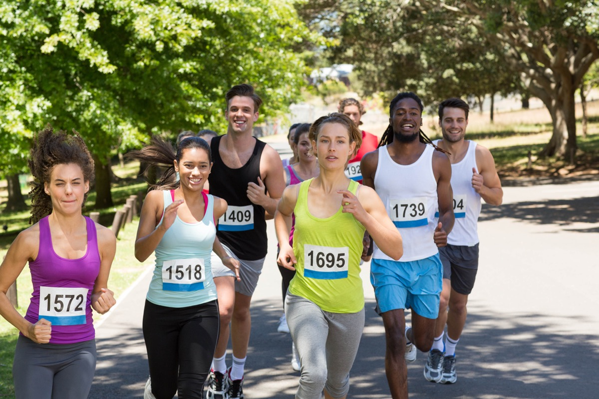 Group of people running a race multicultural
