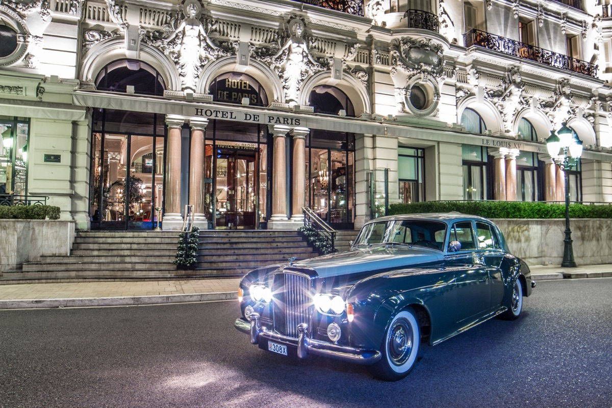 Old fashioned car parked outside Hotel de Paris in Monte Carlo