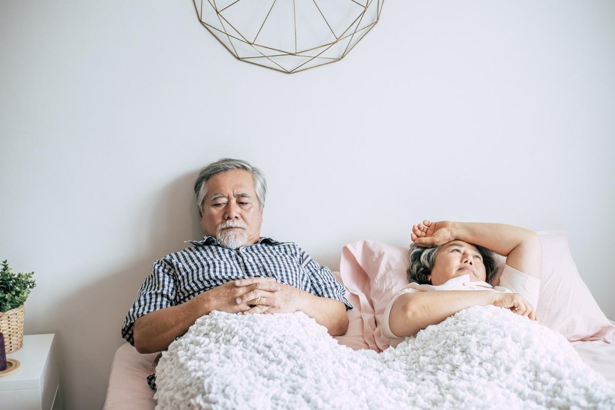 older couple fighting in bed men's health concerns over 40