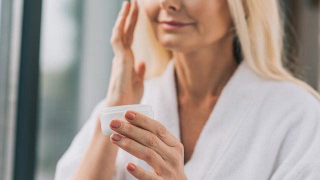 Older Woman Applying Makeup, look better after 40
