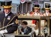 princess eugenie and jack brooksbank at their wedding in a carriage