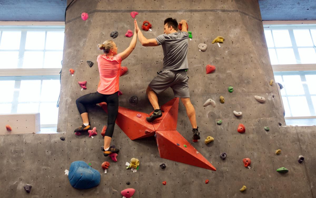 Couple doing rock climbing
