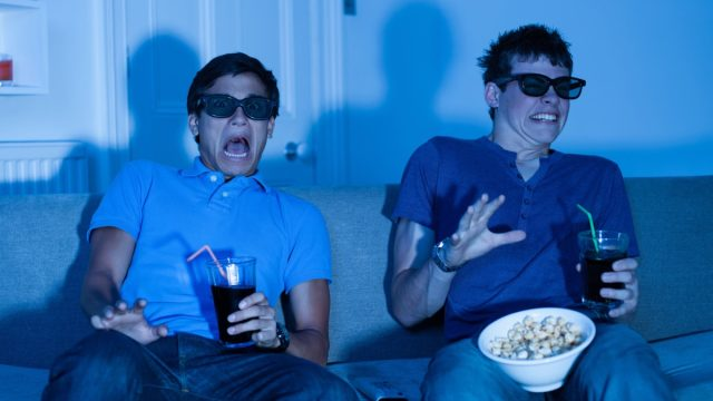 Two boys scared watching a scary movie