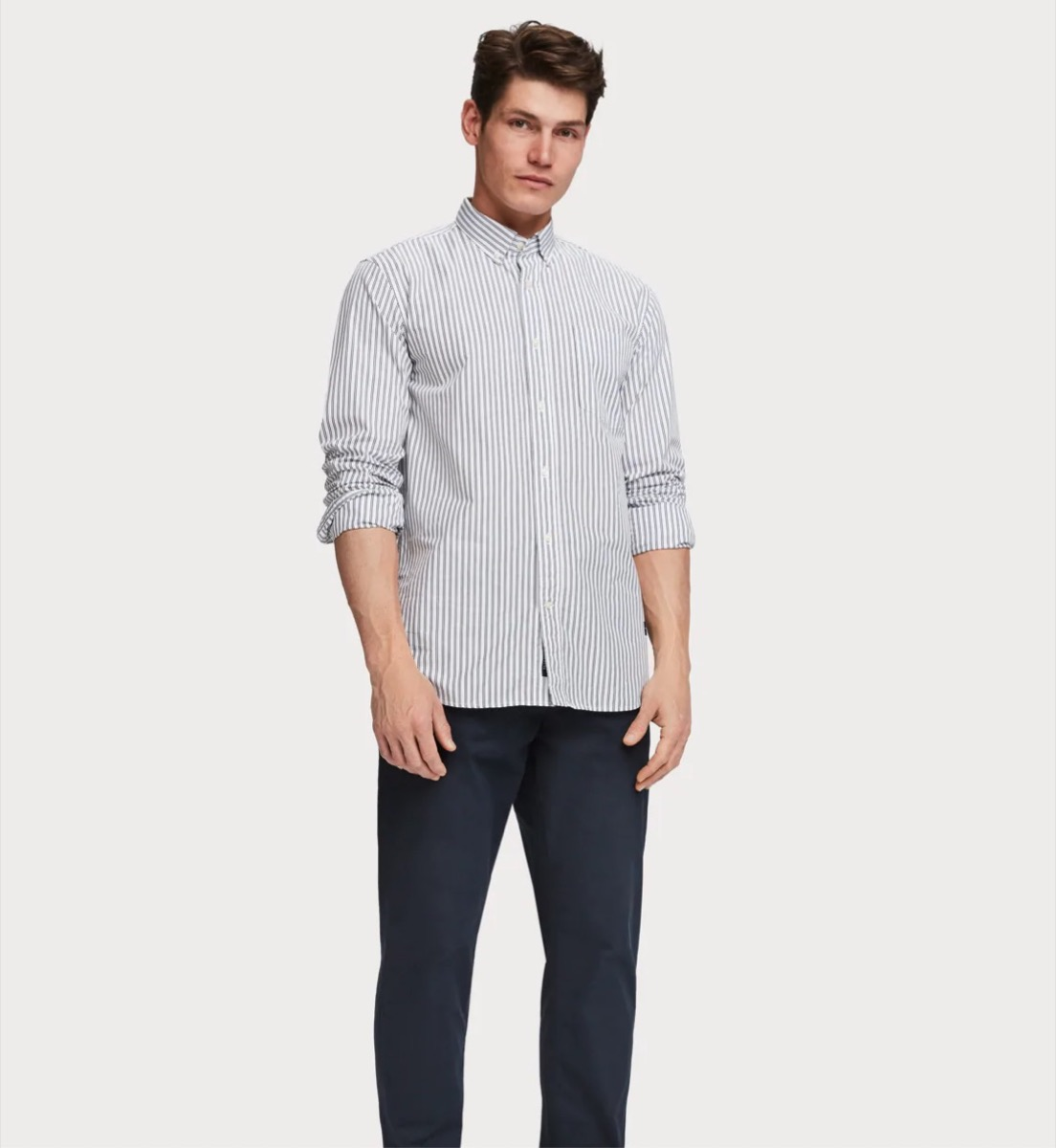 young white man in button down and dark pants