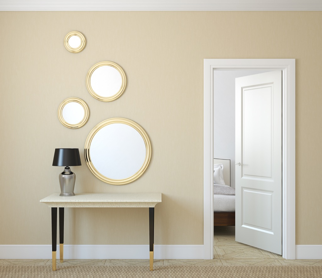 four mirrors hanging in living room