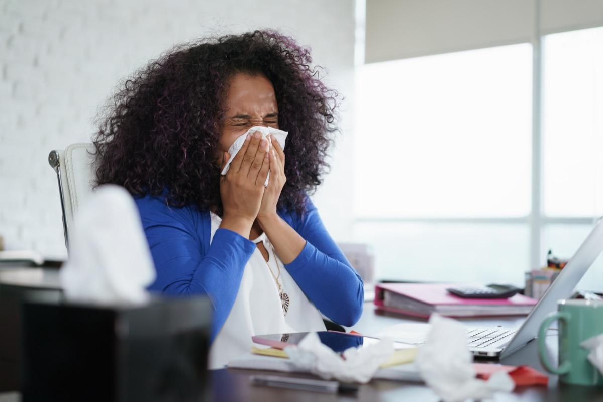 woman sneezing into tissue, relationship white lies
